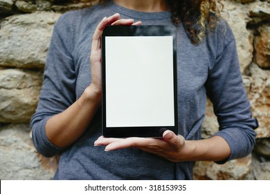 Young women showing blank tablet computer screen(upright)