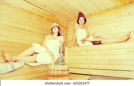 young women  sits on bench in  sauna