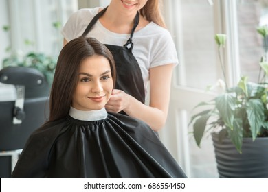 Young women sitting in beauty hair salon style