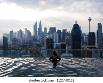 Young Women in Sky Pool Looking for famous building view, KLCC, Kualalumpur