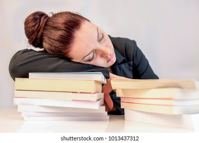 Young women sleep on stack of books isolated on white