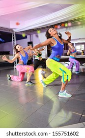 young women in sport dress at an aerobic exercise class