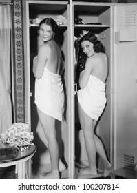 Young women in towels in locker room