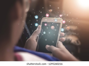 Young women using phones to broadcast live social media concepts, smartphones, social media, social networking concepts with smartphones