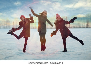 young women walking and having fun in the winter in the snow field