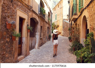 Young women is walking on Valldemossa street, Mallorca island, Balearic Islands, Spain