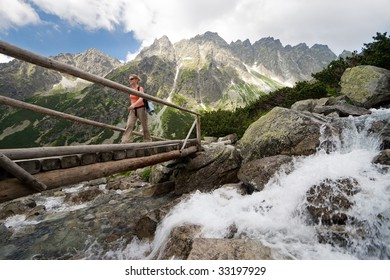 Young women walking through footbridge in High Tatra Mountains, Slovakia