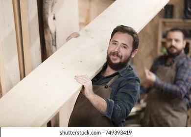 Young wood designer working in workshop.