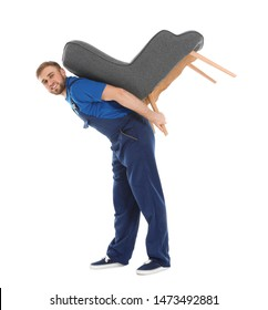 Young worker carrying armchair isolated on white. Moving service