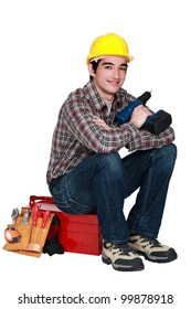 Young worker with a drill