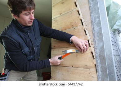 Young worker in a house under construction