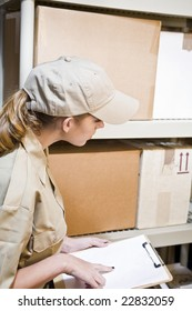 A young worker taking inventory in a warehouse