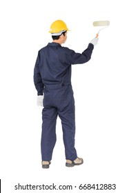 Young worker in a uniform using a paint roller is painting invisible floor, isolated on white background cutout