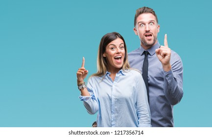 Young workers business couple over isolated background pointing finger up with successful idea. Exited and happy. Number one.