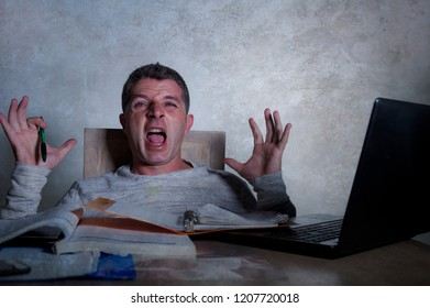 young worried and desperate man working late night at home desk with laptop computer screaming frustrated and tired accounting paperwork or studying for exam isolated suffering anxiety crisis