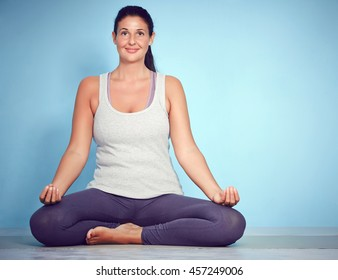 Young Yoga Woman In Lotus Position