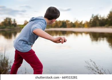 young-boy-skimming-stones