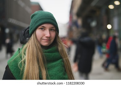 Younge girl portrait on street on late autumn or early spring