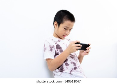 Younger Asian poor boy got a new smartphone and looks happy. Social network concept.