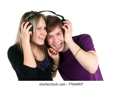 younger pair listens music in headphones