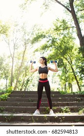 Young,strong, beautiful, slender girl doing fitness in the park