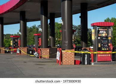 Youngsville, NC United States- 05-13-2021: Yellow tape marks empty pumps at a deserted gas station. Fuel reserves in NC were depleted after the Colonial Pipeline was shutdown in a cyber attack.
