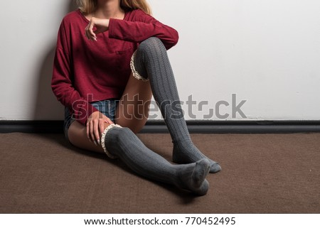 Young Teen Model With Knee High Socks Sitting On A Floor