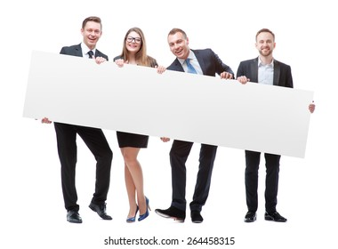 Your advertisement in good hands. Group of handsome young business people holding big blank with copy space. Isolated on white.