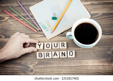 Your Brand. Wooden letters on the office desk, informative and communication background