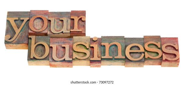your business words in vintage wood letterpress printing blocks, stained by color inks, isolated on white