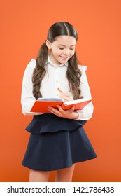 Your career path begins here. Child doing homework. Write essay or notes. Inspiration for study. Back to school. Knowledge day. Schoolgirl enjoy study. Kid school uniform hold workbook. School lesson.