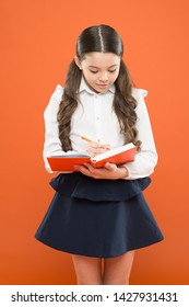 Your career path begins here. Write essay or notes. Inspiration for study. Back to school. Knowledge day. Schoolgirl enjoy study. Kid school uniform hold workbook. School lesson. Child doing homework.