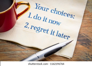 Your choices - do it now or regret it later, motivational handwriting on napkin with a cup of coffee