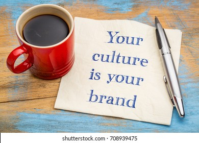 Your culture is your brand - handwriting on a napkin with a cup of coffee