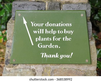 """Your Donation will Help to Buy Plants for the Garden, Thank You"" Sign in the Grounds at Hare Hill, near Alderley Edge in the Cheshire Countryside, England, UK"