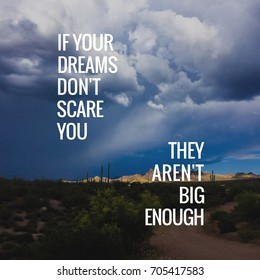 If Your Dreams Don't Scare You typography design on image of desert mountain landscape.