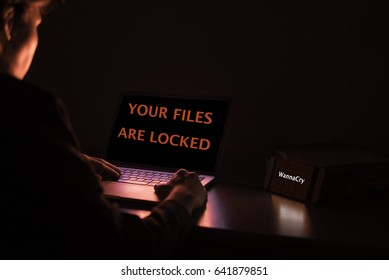 your files are locked then give me your money are you wanna cry and ransomware on laptop or notebook and mobile phone,cyber attack internet security concept.