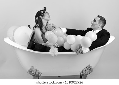 Your hair care routine. Couple of mime man and sexy woman enjoy bathing. Couple in love in bath tub. Bubble bath day. Beauty routine and personal hygiene. Hair grooming routine. Bathing hygiene habit.