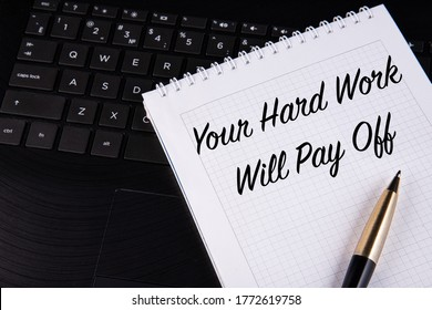 Your Hard Work Will Pay Off - written on a notebook with a pen.
