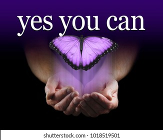 Your Mentor says YES YOU CAN - Male cupped hands emerging from black background with a large purple coloured  butterfly rising upwards towards the words YES YOU CAN
