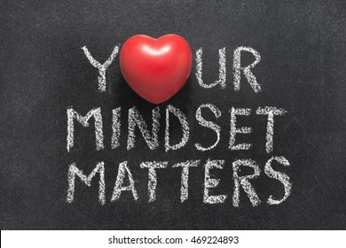 your mindset matters phrase handwritten on blackboard with heart symbol instead of O