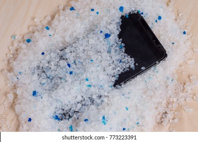 Your phone wet - putting it in a bag of silica gel filler to absorb the moisture. Wet smartphone repair in silica gel filler from your cat's
