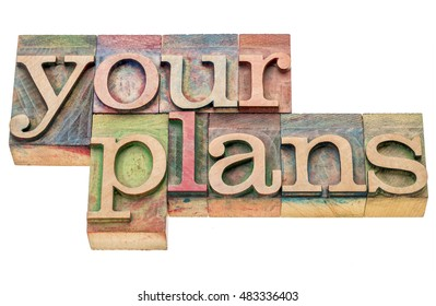 your plans - isolated word abstract in letterpress wood type printing blocks stained by color inks