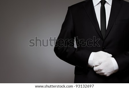 At Your service. Waiter, or well dressed man waiting for orders with copy space