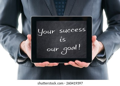 Your success is our goal! Businessman holding tablet pc with chalkboard screen