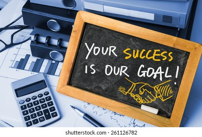 your success is our goal handwritten on blackboard
