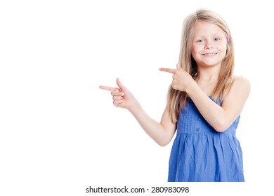 Your text here. Pretty little girl pointing copy space. Isolated on white.