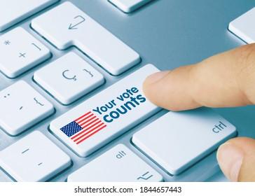 Your vote counts Written on Blue Key of Metallic Keyboard. Finger pressing key.