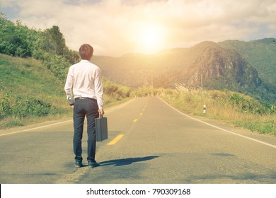 Your way to success Business,Elegant businessman on road standing with back and looking ahead