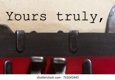 Yours truly typed on an old vintage paper with od typewriter font.